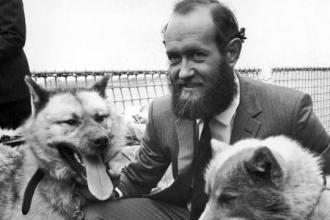 Sir Wally Herbert with two sled dogs